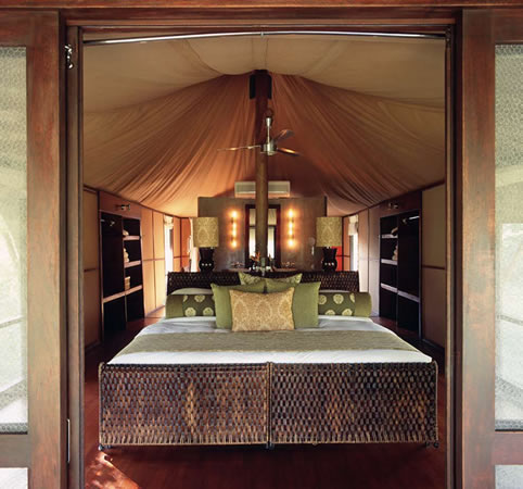 ... niches in the spacious suite. An oversized bathtub awaits on a wooden platform where gauze screens open up to the outside and give the effect of ... & Ngala Tented Camp